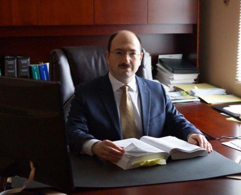 Eugene Sherayzen, Esq. International Tax Attorney.
