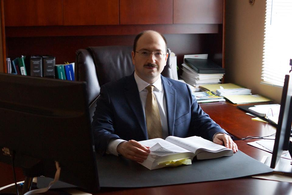Eugene Sherayzen, Esq. International Tax Attorney.